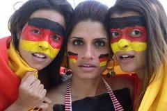 Fans de foot allemands préoccupés par la performance d'équipe. Photographie stock