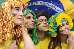 Fans de foot brésiliens concernés. Photographie stock