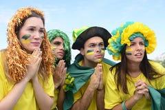 Fans de foot brésiliens concernés Image libre de droits