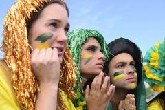 Fans de foot brésiliens concernés par la performance de l'équipe nationale brésilienne Photographie stock