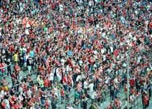 Fans en rojo y blanco Foto de archivo libre de regalías