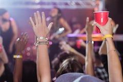 Fans enjoying music concert. At nightclub Stock Photos