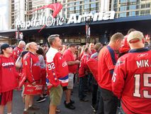 Fans Gather Outside the Capital One Arena. Photo of fans wearing red t shirts at the capital one arena in downtown washington dc on 6/4/18. They are waiting to royalty free stock image