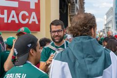 Fans go to the stadium. June 27, 2018. Yekaterinburg. 3 hours to match. Match Mexico - Sweden Royalty Free Stock Images