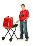 Fans: Guy Grilling for Tailgate Party Royalty Free Stock Photos