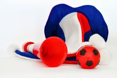Fans hat football cheer and vuvuzela and soccer ball. On white background stock images