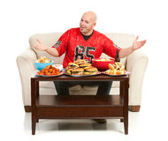 Fans : Homme excité pour manger des casse-croûte Photo libre de droits