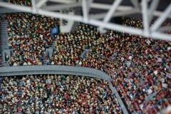Fans i fotbollsarena i Munichmade från det plast- legokvarteret royaltyfri bild