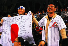 Fans of Japan. Japanese baseball fans cheer for their home country Royalty Free Stock Photography