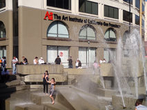 Fans jump into the water fountain to celebrate Royalty Free Stock Photos