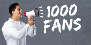 1000 fans likes thousand social networking media young man megap. Hone bullhorn Royalty Free Stock Photography