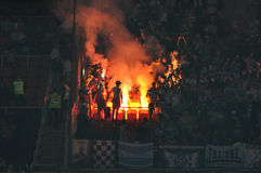 Fans lit a fire in the stands Stock Photography