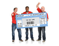 Fans: Men Hold Up Giant Football Ticket. Extensive series, of male and female fans of American football. Watching from a couch, tailgating, and more royalty free stock photography