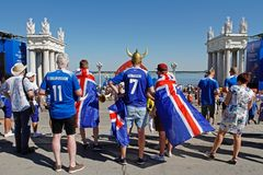 Fans of the national team of Iceland with national flags watching the match at the FIFA Fan Fest on the Central promenade in Volgo royalty free stock image