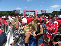 Fans Near the Stage at the Rally on the National Mall. Photo of red shirted washington capitals fans and stage at the rally at the national mall in downtown royalty free stock photography