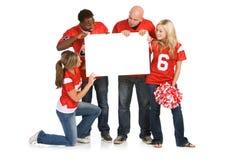 Fans : Passionés du football regardant le signe vide Photos stock