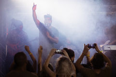 Fans photographing male singer performing at nightclub Royalty Free Stock Images