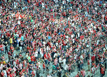 Fans in red and white. Bayern Munich fans on Allianz Arena Royalty Free Stock Photo
