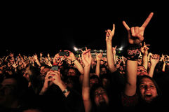 Fans rising hands up. SERBIA, BELGRADE - MAY 27, 2013: Excited fans rising hands up in the air at rock concert stock images