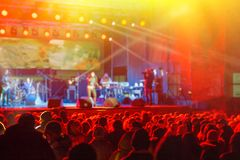 Fans and rock musicians during the performance. Evening rest.  Web banner stock images