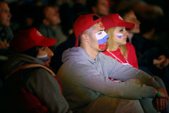 Fans russes avec les symboles sur le visage Photographie stock