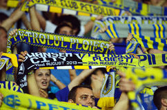 Fans with scarves in Petrolul Ploiesti-Swansea FC Royalty Free Stock Photos