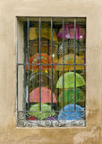 Fans. Of several colors in a window Stock Photo