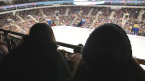Fans sit on the ice arena during the World Cup in figure skating. Fans sit on the ice arena during the World Cup in figure skating stock video