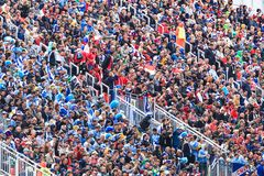 Fans are sitting and watching football Royalty Free Stock Images