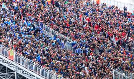 Fans are sitting and watching football Royalty Free Stock Image