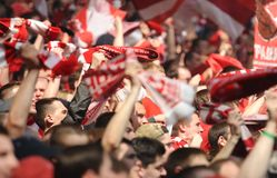 Fans of Spartak Moscow cheer on their team during a friendly game against FC Dynamo. Russia, Moscow, August 2015 : Fans of Spartak Moscow cheer on their team royalty free stock images