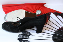 Fans, special flamenco shoes and Manton flamenco. Red and white fans, special red and black flamenco shoes and Manton flamenco Royalty Free Stock Photo