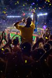 Fans on stadium game. Fans on stadium soccer game Confetti and tinsel stock images