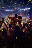 Fans on stadium game. Fans on stadium soccer game Confetti and tinsel royalty free stock images