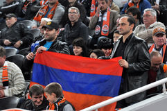 Fans stretched the Armenian flag on the podium Stock Photography