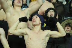 Fans support their team. KHARKIV, UKRAINE - DECEMBER 1: Topless fans support Metalist Kharkiv during Group stage UEFA Europe League football match vs. Debrecen Stock Photos