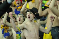 Fans support their team. KHARKIV, UKRAINE - DECEMBER 1: Topless fans support Metalist Kharkiv during Group stage UEFA Europe League football match vs. Debrecen Royalty Free Stock Photography