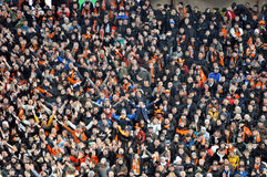 Fans and supporters on one sector. During the match between Shakhtar (Donetsk, Ukraine) vs Juventus (Turin, Italy) December 5, 2012. Donetsk. Donbass Arena Royalty Free Stock Image