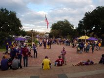 Fans tailgating during an LSU football game. BATON ROUGE, LOUISIANA, USA - 2018: Fans tailgating during an LSU football game, with Tiger Stadium in the stock image