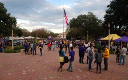 Fans tailgating during an LSU football game. BATON ROUGE, LOUISIANA, USA - 2018: Fans tailgating during an LSU football game, with Tiger Stadium in the royalty free stock photos