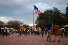 Fans tailgating during an LSU football game. BATON ROUGE, LOUISIANA, USA - 2018: Fans tailgating during an LSU football game, with Tiger Stadium in the royalty free stock photo