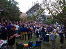 Fans tailgating during an LSU football game. BATON ROUGE, LOUISIANA, USA - 2018: Fans tailgating during an LSU football game, with Tiger Stadium in the stock photography