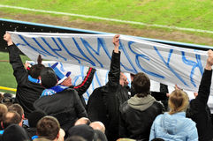 Fans of the team Dnipro raise the banner Stock Photos