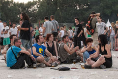 Fans at Tuborg Green Fest. People at rock festival siting and drinking beer. Photo taken at Tuborg Green Fest 2012 in Bucharest Stock Photo