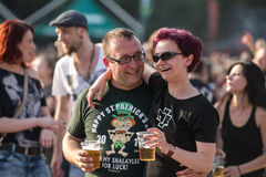 Fans at Tuborg Green Fest. People at rock festival drinking beer. Photo taken at Tuborg Green Fest 2012 in Bucharest stock images