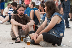 Fans at Tuborg Green Fest. People at rock festival siting and drinking beer. Photo taken at Tuborg Green Fest 2012 in Bucharest royalty free stock images