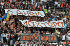 Fans unfurled banners reading. Miner's Day! during the match between Shakhtar (Donetsk City) and Karpaty (Liviv City) in Ukrainian championship. 08/26/2012 Stock Photo