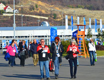 Fans and volunteers at the entrance to the Olympic Park Stock Photo