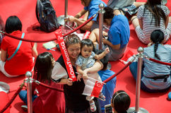 Fans waiting for Joseph Schooling, the Singapore's first Olympic gold medalist, at Raffles City. August 18, 2016. Crowd waiting with colourful banners to get stock photos