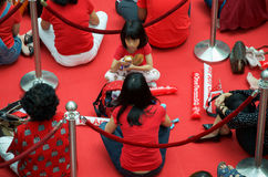 Fans waiting for Joseph Schooling, the Singapore's first Olympic gold medalist, at Raffles City. August 18, 2016. Crowd waiting with colourful banners to get royalty free stock images